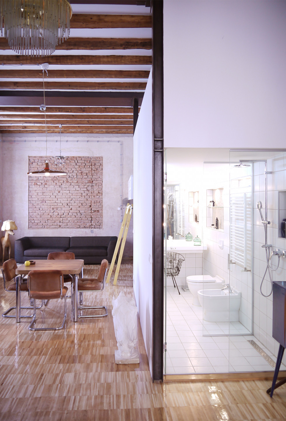 Loft T in Zagreb • living room and bathroom